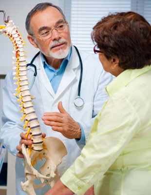 Chiropractor explaining the spine to a patient