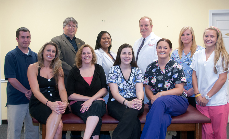 staff group picture of McCarrin Chiropractic office